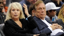 Donald Sterling sitting with his wife Shelly