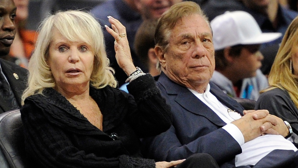 Los Angeles Clippers owner Donald T. Sterling, right, sits with his wife Shelly in Los Angeles, on Nov. 12, 2010. (AP / Mark J. Terrill)