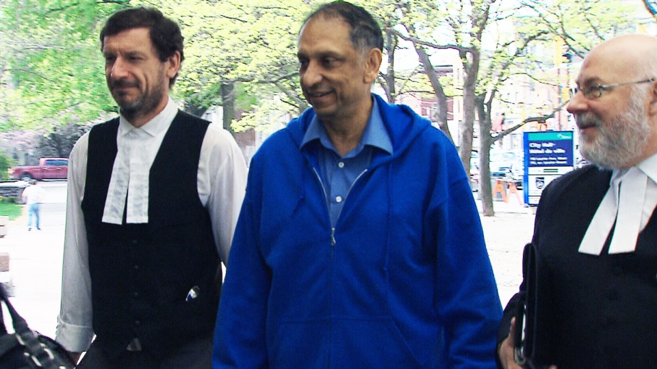 Nazir Karigar, centre, was found guilty last fall for his role in an attempt to arrange payments to bribe Indian officials.