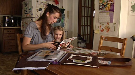Jennifer Levac said she keeps a binder of coupons to help when she does shopping Monday, Nov. 21, 2011.