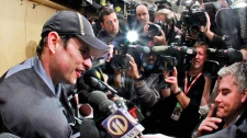 Pittsburgh Penguins' Sidney Crosby, left, is surrounded by media at his locker after a morning skate in preparation for his return to NHL hockey action against the New York Islanders in Pittsburgh,  Monday, Nov. 21, 2011. (AP / Gene J. Puskar)