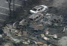 An aerial view of the explosion site from a CTV helicopter shows burnt cars and debris littering the property at Sunrise Propane Industrial Gases on Tuesday, Aug. 12, 2008.