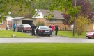 A male, second from right, is arrested by police in Stathroy, Ont. on Friday, May  23, 2014. (Viewer submitted photo.)