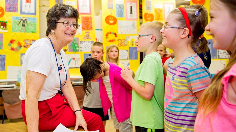 Retiring third grade teacher Jeanne Lorenzen talks with her students in her classroom at Trinity Lutheran School. (AP Photo/Lincoln Journal Star, Kristin Streff)