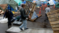 Protesters clean up the Occupy Vancouver site in downtown Vancouver on Monday, Nov. 21, 2011.  (Darryl Dyck / THE CANADIAN PRESS)