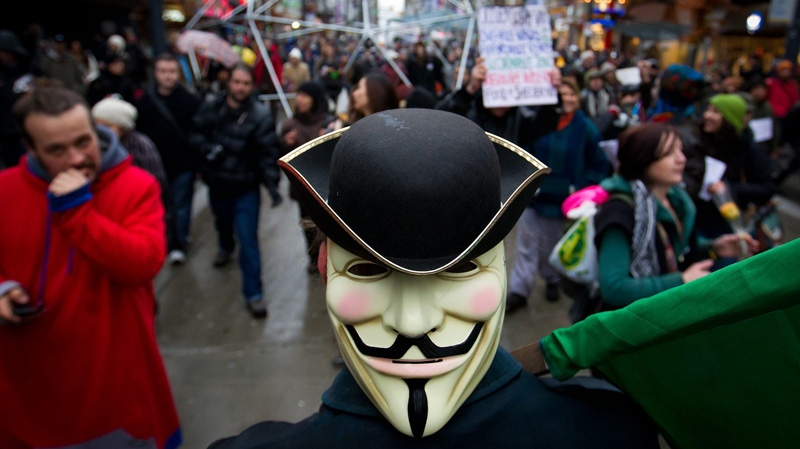 Protesters march through downtown streets after vacating the Occupy Vancouver site in Vancouver, B.C., on Monday Nov. 21, 2011.  (Darryl Dyck / THE CANADIAN PRESS)