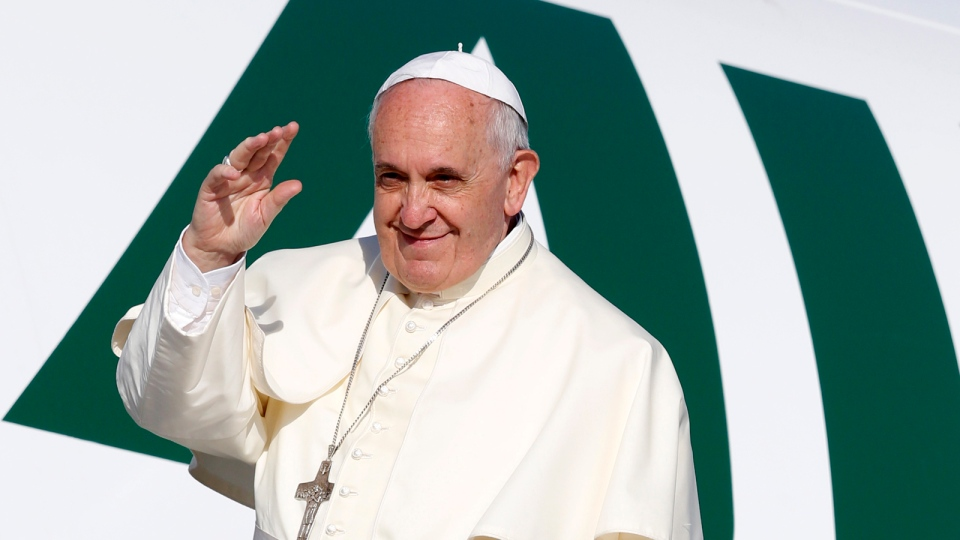 Pope Francis waves to reporters as he boards a plane to Amman, Jordan, for a three-day trip to the Middle East including the West Bank and Israel, at Rome's Fiumicino international airport, Saturday, May 24, 2014. (AP / Riccardo De Luca)