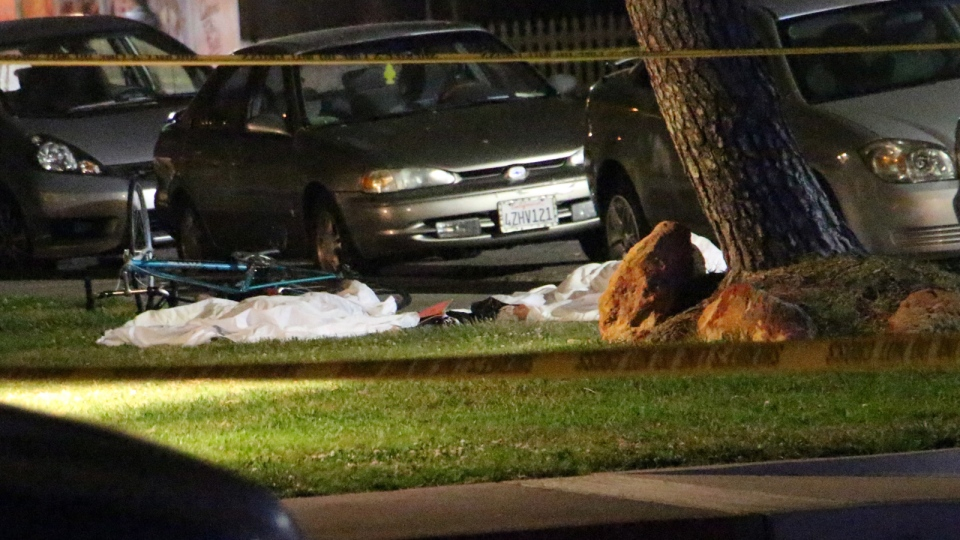 In this image provided by KEYT-TV, bodies are seen covered on the ground after a mass shooting near the campus of the University of Santa Barbara in Isla Vista, Calif., Friday, May 23, 2014. (AP / KEYT, John Palminteri)