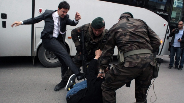 Turkish PM aide fired after kick photos