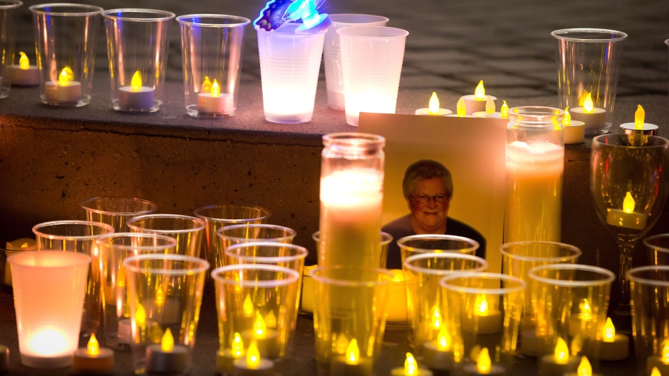 A photograph of the late Julie Paskall is surrounded by candles during a vigil in Surrey, B.C., on Saturday January 18, 2014. (Darryl Dyck / THE CANADIAN PRESS)