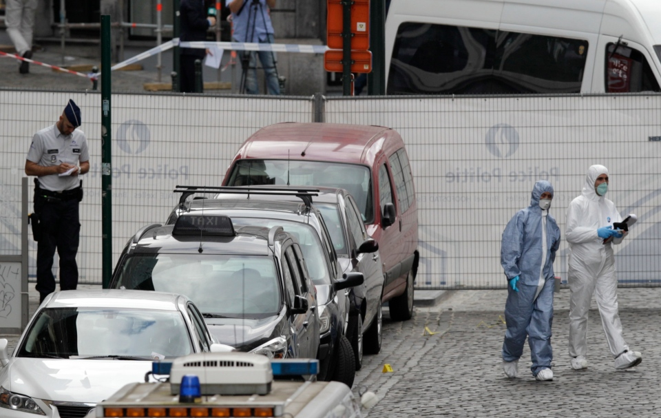Forensic experts examine the site of a shooting at the Jewish museum in Brussels on Saturday, May 24, 2014. (AP / Yves Logghe)