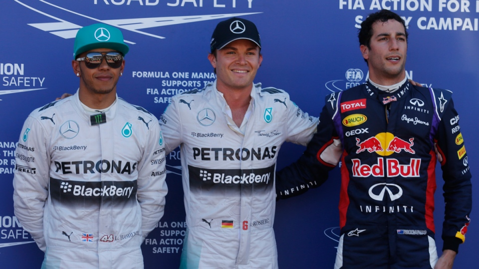 Mercedes driver Nico Rosberg of Germany, center, is flanked by his teammate Lewis Hamilton of Britain, left, and Red Bull driver Daniel Ricciardo of Australia after the qualifying session at the Monaco racetrack, in Monaco, Saturday, May 24, 2014. (AP Photo/Luca Bruno)
