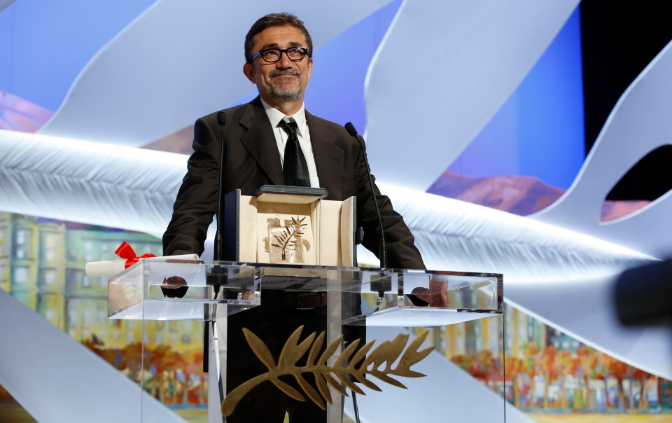 Director Nuri Bilge Ceylan makes a speech after winning the Palme d'Or award for the film 'Winter Sleep' during the awards ceremony for the 67th Cannes International Film Festival on Saturday, May 24, 2014. (AP / Alastair Grant)