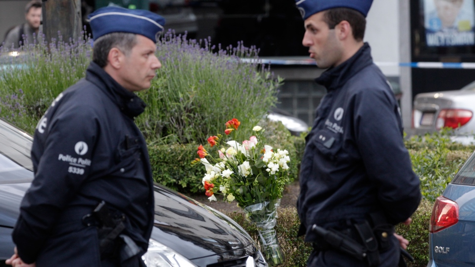 Some flowers were put close to the site of a shooting at the Jewish museum in Brussels, Saturday, May 24, 2014. (AP / Yves Logghe)