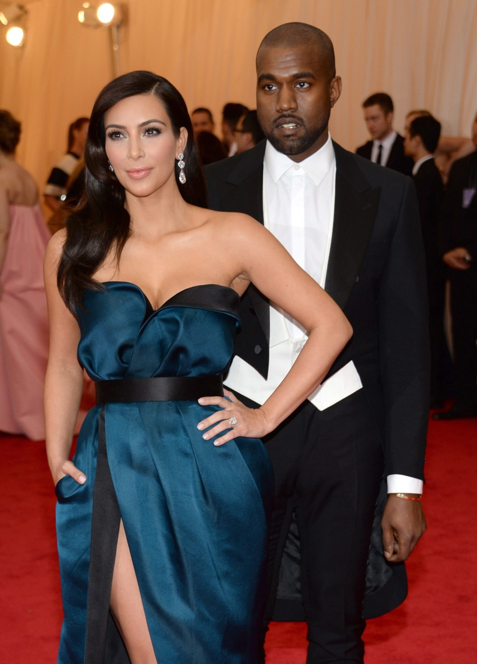 "Kim Kardashian, left, and Kanye West attend The Metropolitan Museum of Art's Costume Institute benefit gala celebrating ""Charles James: Beyond Fashion"" on Monday, May 5, 2014, in New York. (Photo by Evan Agostini/Invision/AP)"
