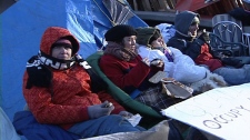 Occupy Ottawa's remaining campers huddle up in sub-zero temperatures Tuesday, Nov. 22, 2011.