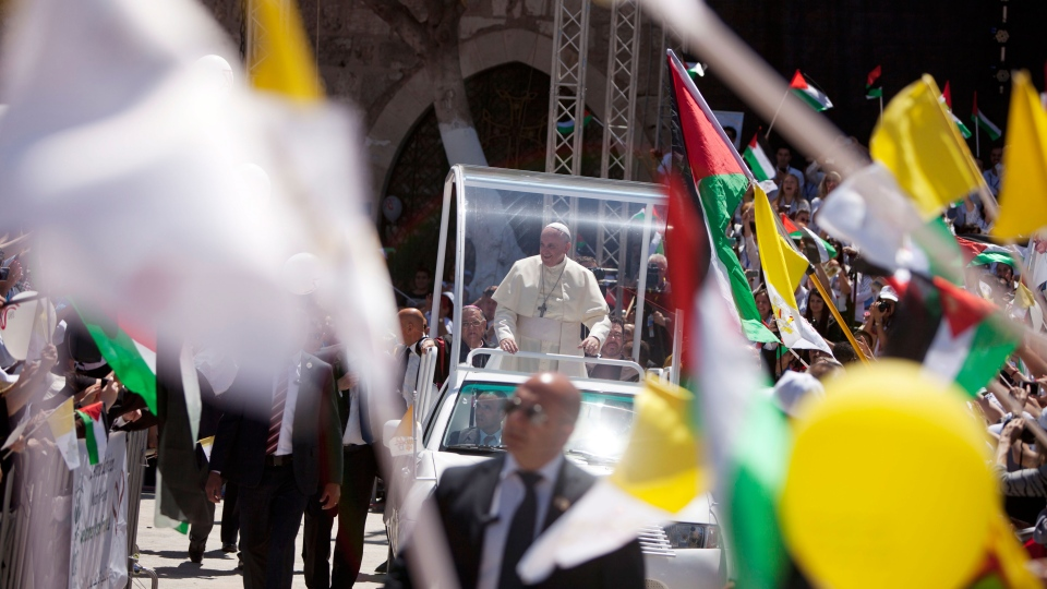 Pope Francis arrives to lead a mass in Manger Square next to the Church of the Nativity, traditionally believed to be the birthplace of Jesus Christ in the West Bank town of Bethlehem, Sunday, May 25, 2014. (AP / Majdi Mohammed)