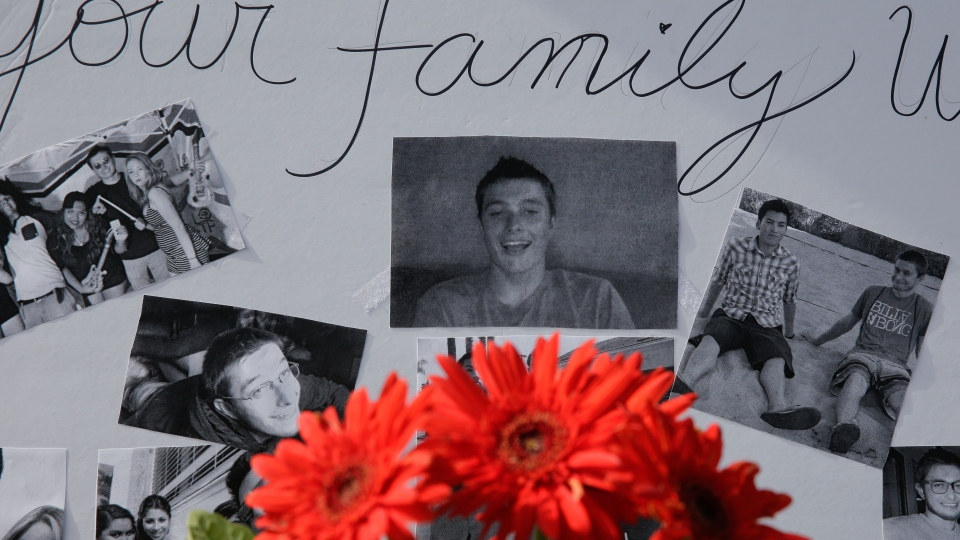 Images of Christopher Martinez are displayed as part of a memorial in front of the IV Deli Mart, where part of Friday night's mass shooting took place, in the Isla Vista beach community of Santa Barbara, Calif. on on Sunday, May 25, 2014. (AP / Chris Carlson)