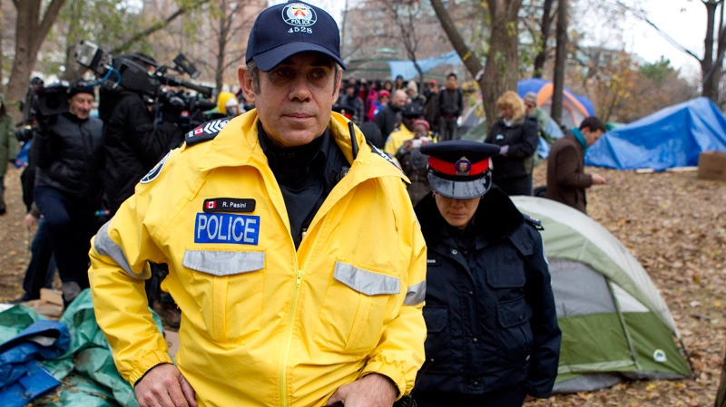 Police officers walk through the Occupy Toronto camp in St.James Park in Toronto as protesters continue to defy an eviction notice after a judge dismissed their appeal to remain on Tuesday Nov. 22, 2011. (Chris Young /  THE CANADIAN PRESS)
