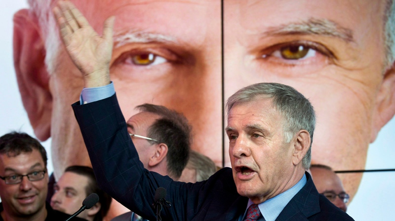 Economist and businessman Marcel Côté gestures July 3, 2013 in Montreal at the launch of his mayoral campaign. Cote passed away on Sunday. He was 71. THE CANADIAN PRESS/Paul Chiasson
