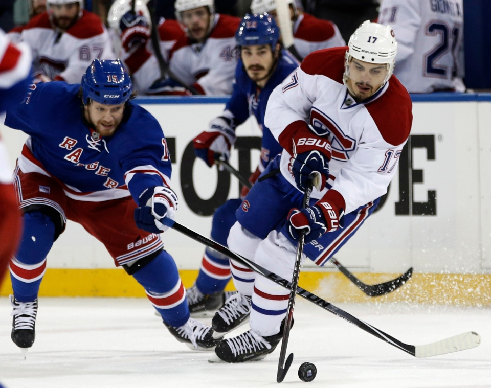 New York Rangers right wing Derek Dorsett (15) defends Montreal Canadiens left wing Rene Bourque (17) during the third period of Game 4 of the NHL hockey Stanley Cup playoffs Eastern Conference finals, Sunday, May 25, 2014, in New York. (AP / Kathy Willens)