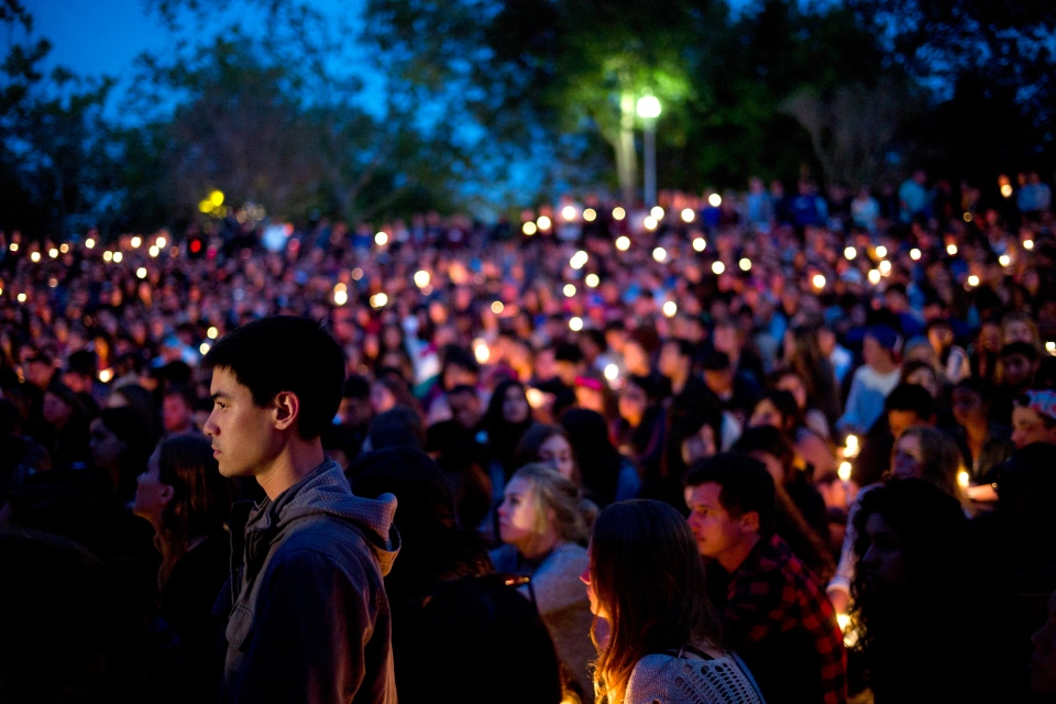 People gather at a park for a candlelight vigil to honour the victims of Friday night's mass shooting on Saturday, May 24, 2014, in Isla Vista, Calif. (AP / Jae C. Hong)