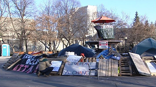 Occupy Ottawa's remaining campers have set up inside a fountain at Confederation Park Tuesday, Nov. 22, 2011.
