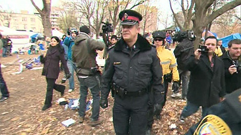 Police inspect the 'Occupy Toronto' campsite at St. James Park on Tuesday, Nov. 22, 2011.