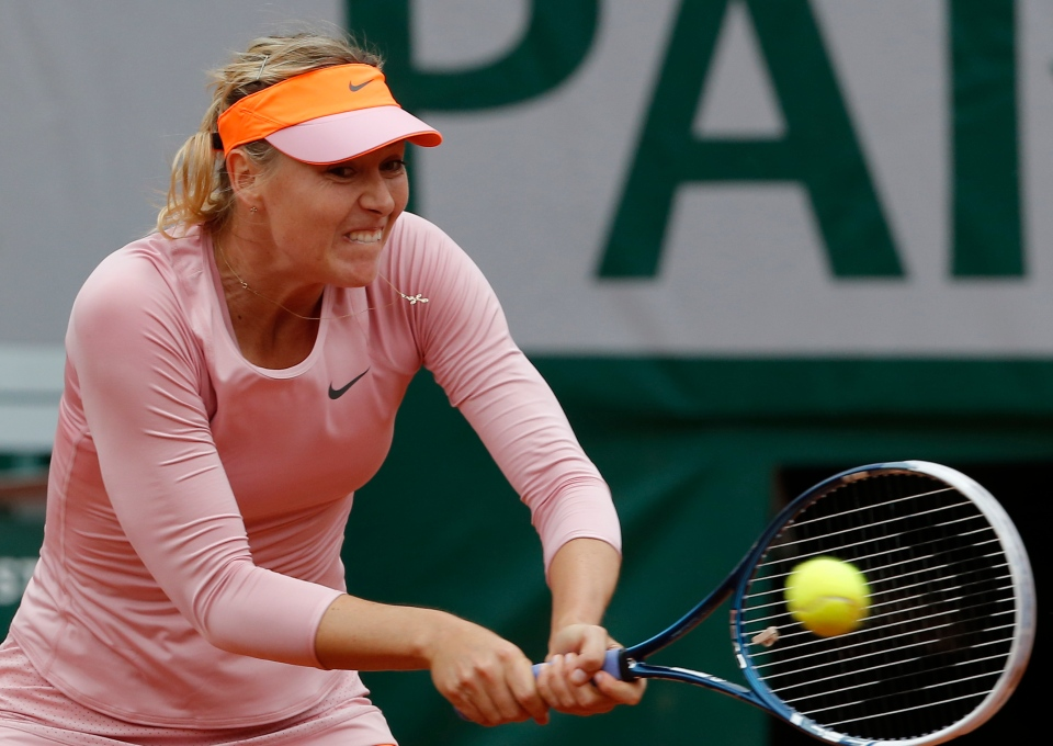 Russia's Maria Sharapova returns the ball to compatriot Ksenia Pervak during their first round match at the French Open tennis tournament at the Roland Garros stadium, in Paris, France, Monday, May 26, 2014. (AP / Michel Euler)