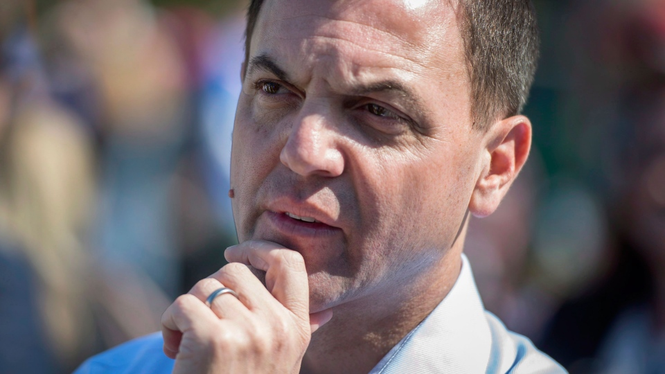 Ontario PC Leader Tim Hudak prepares to speak at the United Jewish Appeal's Walk with Israel while campaigning in Toronto, Ont. on Sunday, May 25, 2014. (Darren Calabrese / THE CANADIAN PRESS)