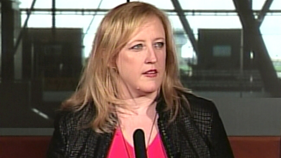 Transportation Minister Lisa Raitt speaks during a press conference, Monday, May 26, 2014.