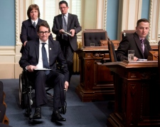 Pierre Karl Peladeau attends QP in wheelchair