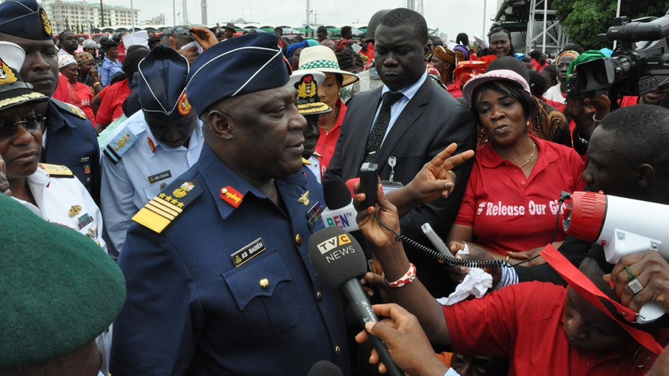 Nigeria's chief of defense staff Air Marshal Alex S. Badeh, centre, speaks during a demonstration calling on the government to rescue the kidnapped girls of the government secondary school in Chibok, in Abuja, Nigeria, Monday, May 26, 2014. (AP / Gbenga Olamikan)