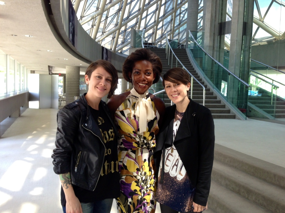 Tegan Quin (left), Andria Case (centre) and Sara Quin (right) pose for a photo on May 26, 2014.