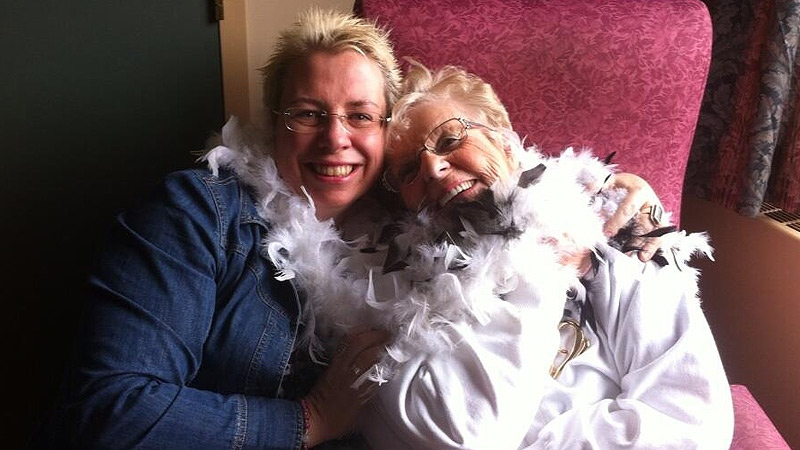 Kendra Whitfield and her mother, Inez, 86, try on feather boas they planned to wear to Lady Gaga's concert at Rexall Place Monday, May 26.