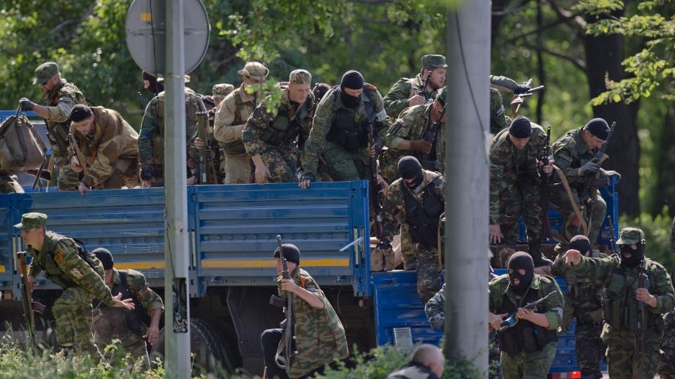 Pro-Russian gunmen take positions near the airport, outside Donetsk, Ukraine, on Monday, May 26, 2014. (AP / Vadim Ghirda)