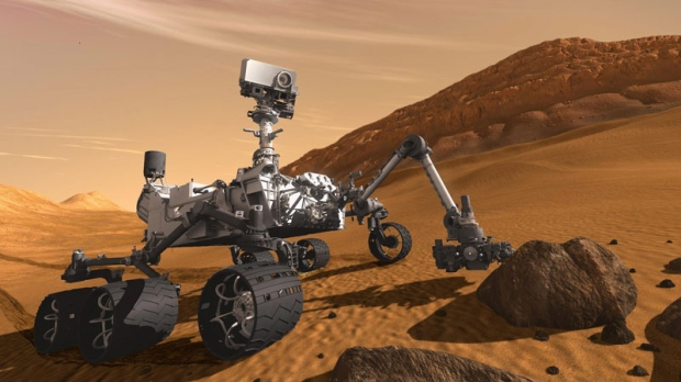 In this 2011 artist's rendering provided by NASA/JPL-Caltech, the Mars Science Laboratory Curiosity rover examines a rock on Mars with a set of tools at the end of its arm, which extends about 2 meters (7 feet). The mobile robot is designed to investigate Mars' past or present ability to sustain microbial life.