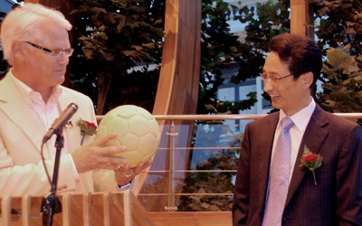 British Columbia Premier Gordon Campbell, left, accepts a gift of a carved soccer ball from Beijing vice-mayor Chen Gang in Beijing on Aug. 9, 2008.  (Stephanie Levitz / THE CANADIAN PRESS)