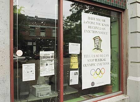 """A poster on Vancouver's East Hastings Street asks Downtown Eastside residents to report """"illegal Olympic evictions."""" (CTV.ca photo/Bill Doskoch)"""