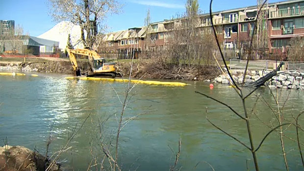 Crews work to shore up the banks of the Bow after they were eroded by the 2013 floods.