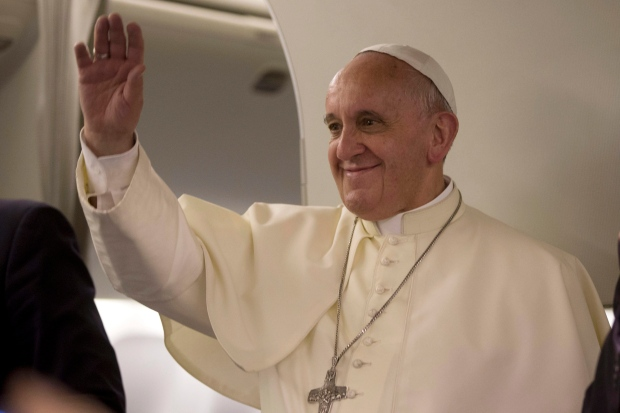 Pope Francis waves on papal flight