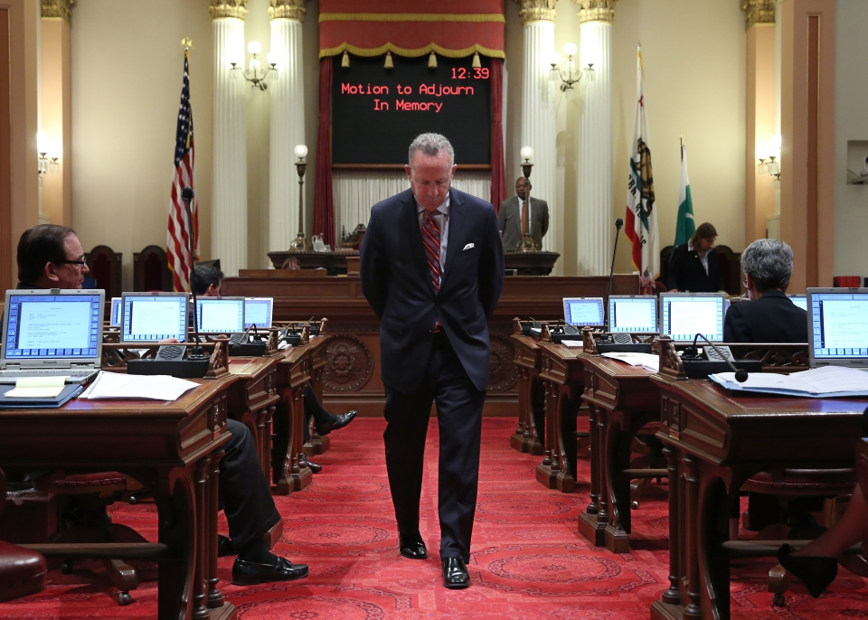 State Senate President Pro Tem Darrell Steinberg, D-Sacramento, paces the floor as he wait to speak about the six young people who were killed last Friday, at the Capitol in Sacramento, Calif., Tuesday, May 27, 2014. (AP / Rich Pedroncelli)