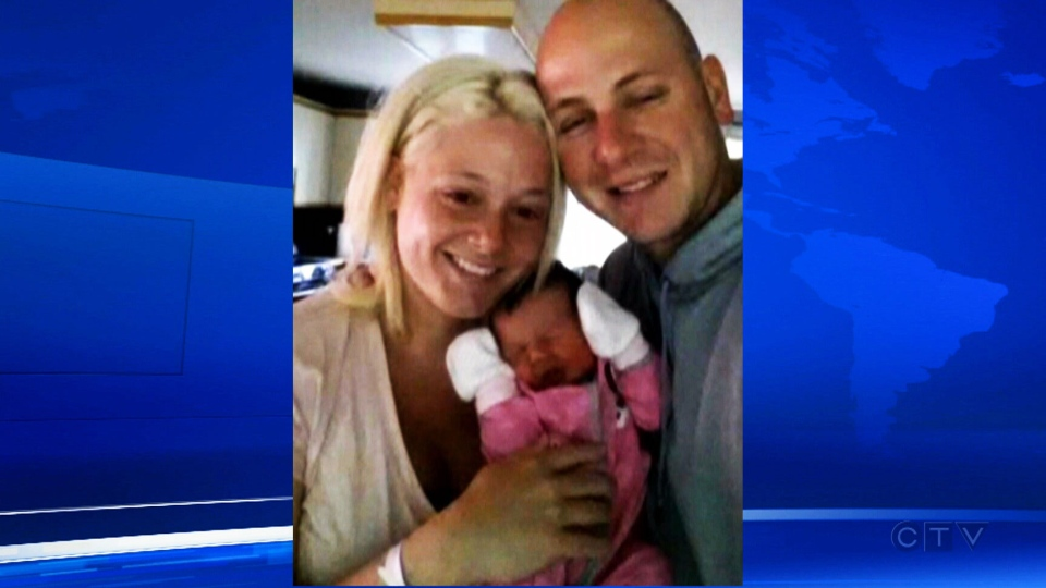 Baby Victoria is seen in this picture with her parents posted to Facebook on Tuesday, May 27, 2014.