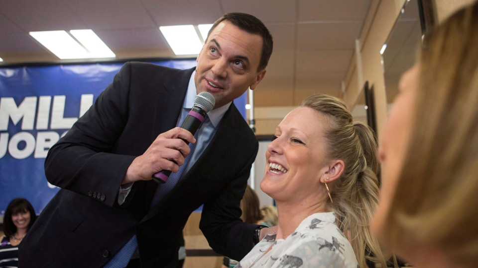 Ontario PC Leader Tim Hudak holds a town hall meeting in a hair salon in Pickering, Ont. on Tuesday, May 27 , 2014. (Chris Young / THE CANADIAN PRESS)