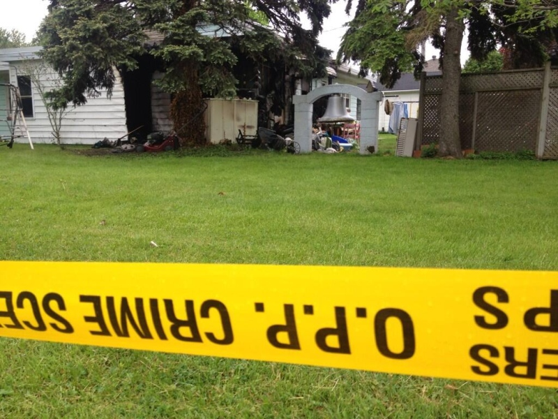 Police tape surrounds a Lakeshore, Ont. property, where a fatal fire occurred on Tuesday May 27, 2014. (Rich Garton/ CTV Windsor)