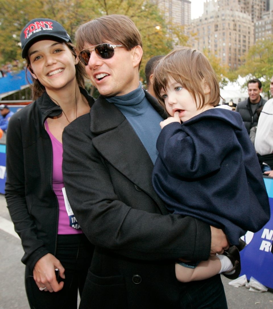 Katie Holmes, Tom Cruise and their daughter, Suri, pose for a photograph after Holmes finished running the New York City Marathon in this Nov. 4, 2007 file photo. (AP / Kathy Willens)
