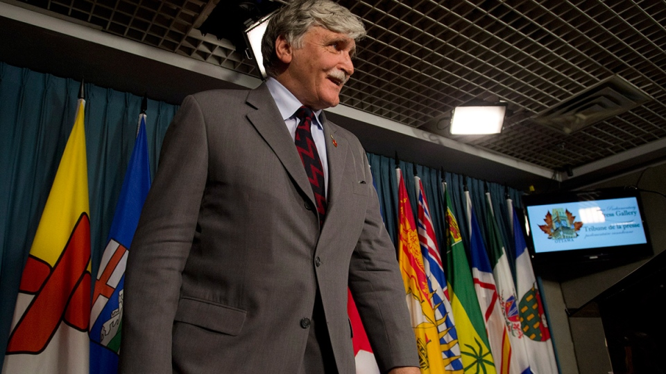 Senator Romeo Dallaire answers a last question as he leaves a news conference on Parliament Hill in Ottawa on Wednesday, May 28, 2014. (Adrian Wyld / THE CANADIAN PRESS)