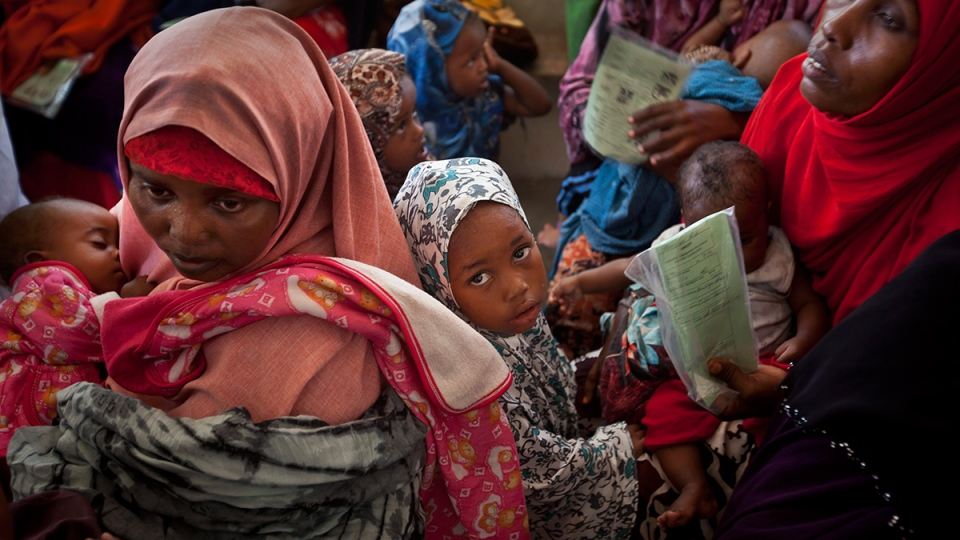 Somali mothers and their babies wait in line for the babies to receive a five-in-one vaccine against several potentially fatal childhood diseases, at the Medina Maternal Child Health center in Mogadishu, Somalia, Wednesday, April 24, 2013. (AP / Ben Curtis)