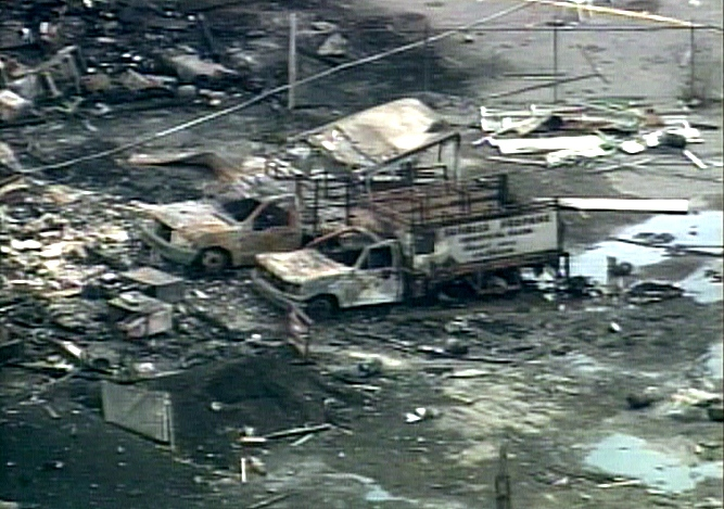 An aerial view of the scene from the CTV helicopter reveals burnt trucks and debris littering the property.