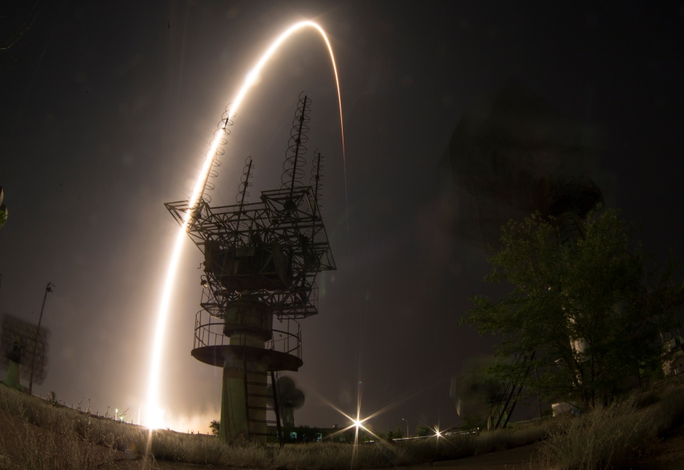 In this photo taken with a fisheye lens and with a long time exposure, the Soyuz-FG rocket booster with Soyuz TMA-13M space ship carrying a new crew to the International Space Station blasts off at the Russian-leased Baikonur cosmodrome, Kazakhstan, Thursday, May 29, 2014 (GMT: Wednesday, May 28). (AP / Dmitry Lovetsky)